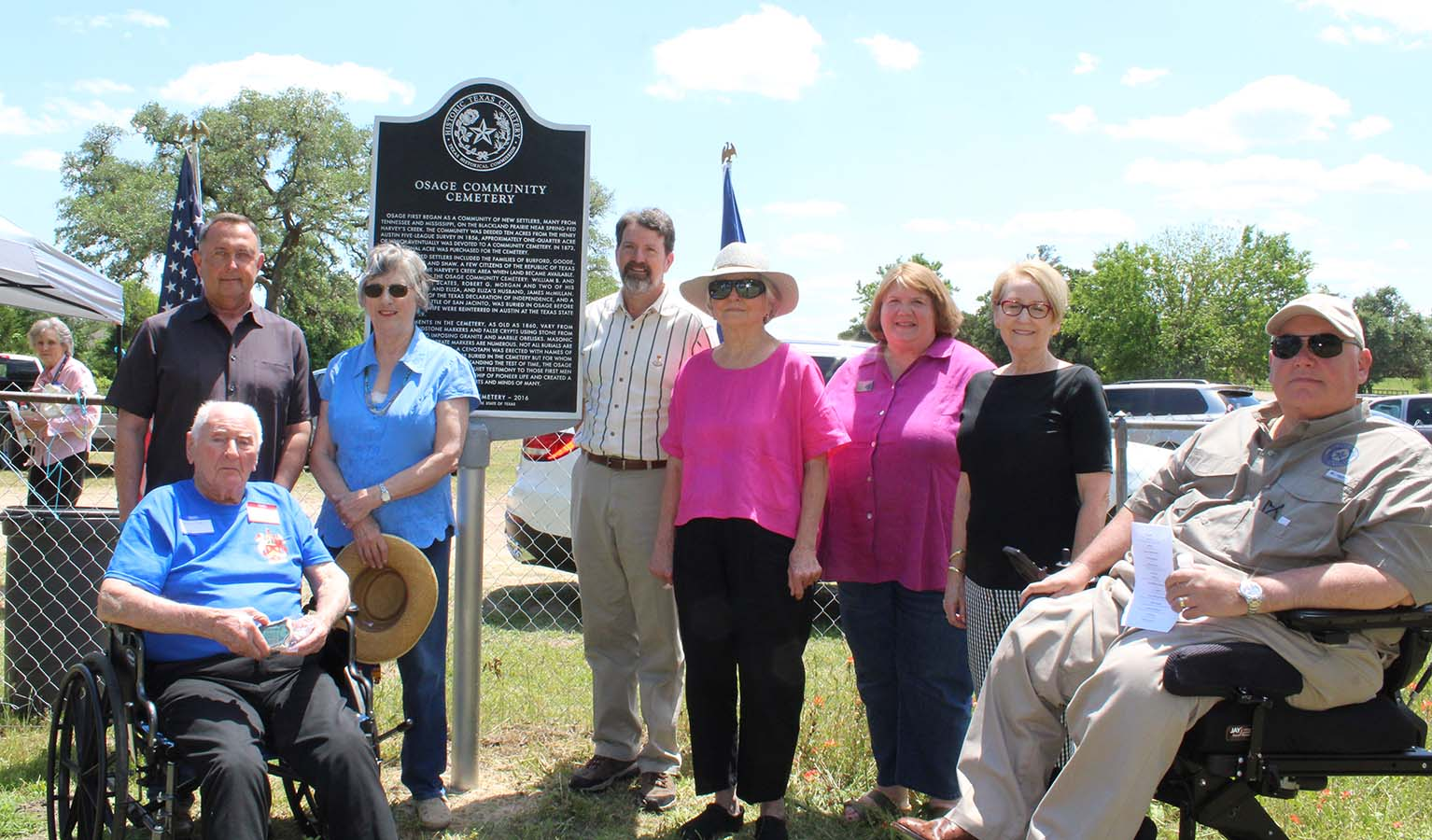 Unveiled marker with program speakers
